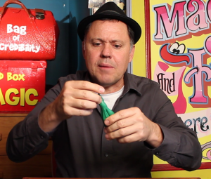 Julian Holds Green Ballon - Cut and Restored Balloon Trick - Magic Lessons #23