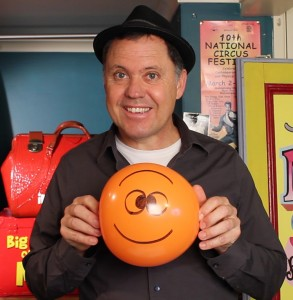 Julian holding Buster Balloon