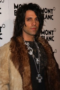 Criss Angel Wearing a Fur Coat at a Red Carpet