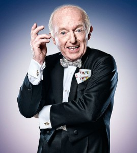 Paul Daniels Posing in a Suit with Cards in His Pocket