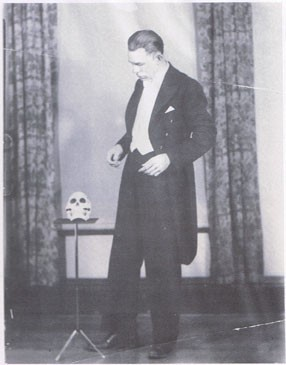 Stewart James Standing With a Skull