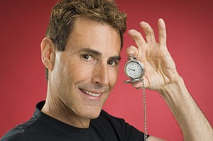 Uri Geller with a Clock