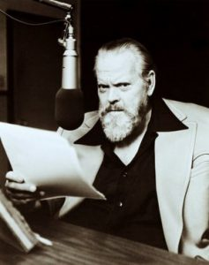 Orson Welles doing a radio broadcast